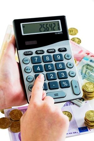 הקשה על מחשבון ברקע של כסף ומטבעות