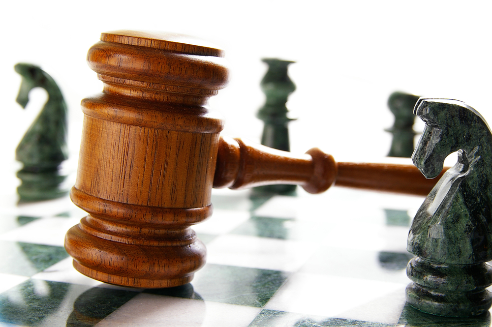 law gavel on a chess board with pieces